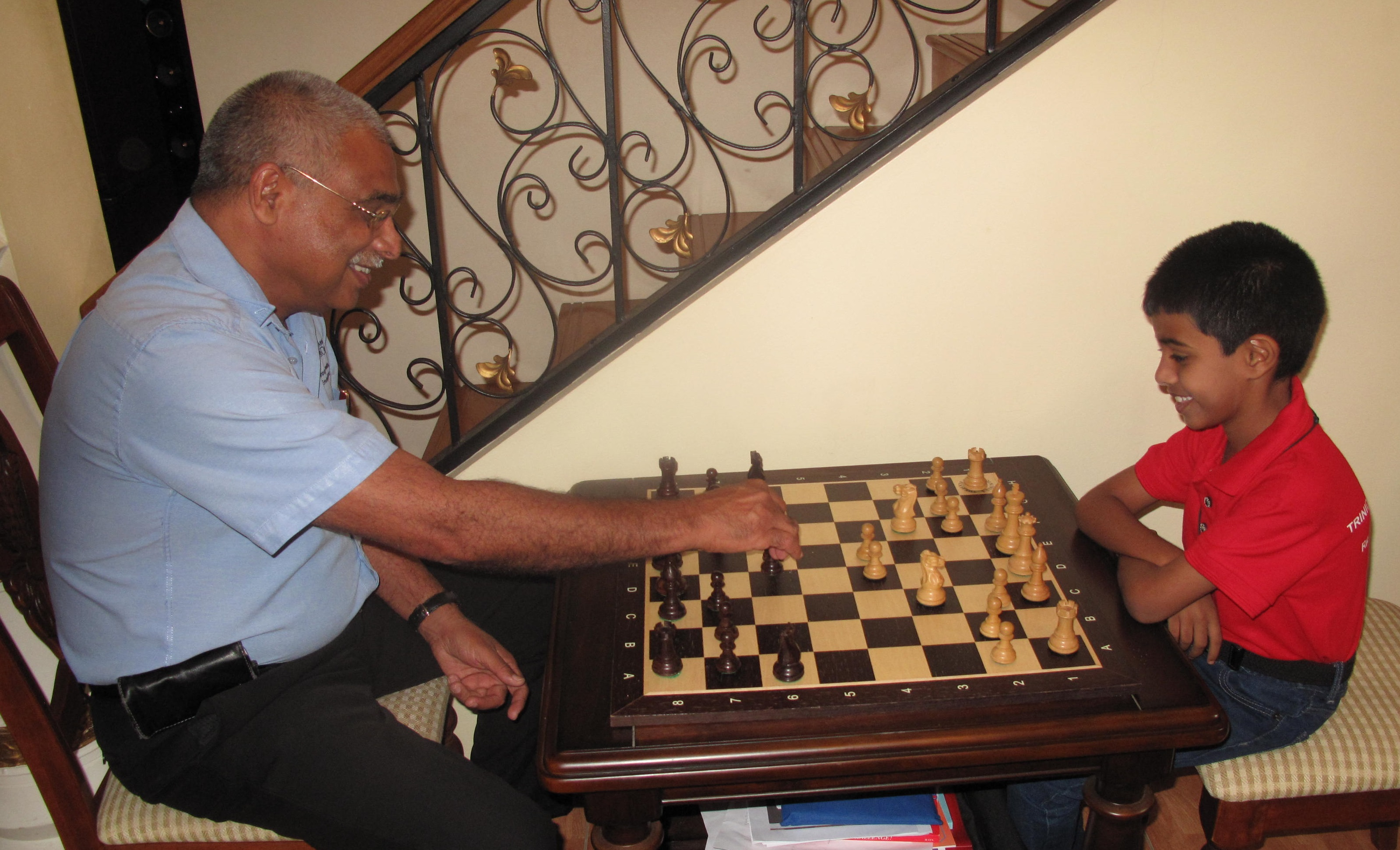 TCL's General Manager (Ag.), Jinda Maharaj, plays a friendly Chess match with Rayden Rampersad.jpg